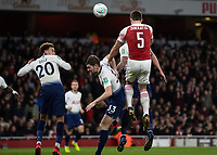 Football - 2018 / 2019 EFL Carabao Cup (League Cup) - Quarter-Final: Arsenal vs. Tottenham Hotspur<br /> <br /> Sokratis Papastathopoulos (Arsenal FC) rises highest as the corner comes in at The Emirates.<br /> <br /> COLORSPORT/DANIEL BEARHAM