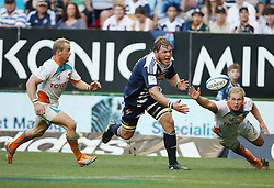 Duane Vermeulen almost gets his hands on the ball while Sarel Pretorius and Philip Snyman tries to prevent the try being scored during the Super Rugby (Super 15) fixture between the DHL Stormers and the Cheetahs held at DHL Newlands Stadium in Cape Town, South Africa on 26 February 2011. Photo by Jacques Rossouw/SPORTZPICS