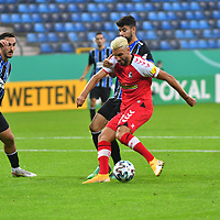 13.09.2020, Carl-Benz-Stadion, Mannheim, GER, DFB-Pokal, 1. Runde, SV Waldhof Mannheim vs. SC Freiburg, <br /> <br /> DFL REGULATIONS PROHIBIT ANY USE OF PHOTOGRAPHS AS IMAGE SEQUENCES AND/OR QUASI-VIDEO.<br /> <br /> im Bild: Onur Uenluefcifci (SV Waldhof Mannheim #7) und Hamza Saghiri (SV Waldhof Mannheim #35) gegen Vincenzo Grifo (SC Freiburg #32)<br /> <br /> Foto © nordphoto / Fabisch