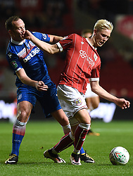 Bristol City's Hordur Magnusson (right) and Stoke City's Charlie Adam (centre) battle for the ball during the Carabao Cup, third round match at Ashton Gate Stadium, Bristol.