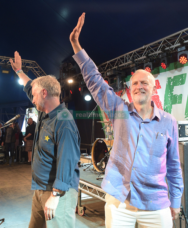Labour leader Jeremy Corbyn with Billy Bragg after he addressed the crowd from the stage at LeftField at Glastonbury Festival, at Worthy Farm in Somerset.