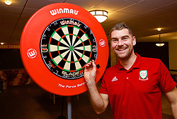 CARDIFF, WALES - Sunday, November 18, 2018: Wales' Sam Vokes with a Winmau dart board at the Vale Resort ahead of the International Friendly match between Albania and Wales. (Pic by David Rawcliffe/Propaganda)