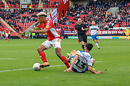 Charlton Athletic attacker Lyle Taylor (9) dribbling past Rochdale midfielder Jimmy Keohane (13) who is on the floor during the EFL Sky Bet League 1 match between Charlton Athletic and Rochdale at The Valley, London, England on 4 May 2019.