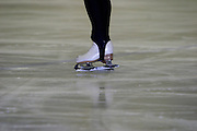 Moscow, Russia, 24/02/2004..AZLK Moskvich chief coach Viktor Kudriatsev training skaters on the club's main ice rink..