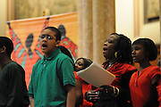 """An ensemble choir of students celebrate the 33rd Annual African American Heritage Month Eucharistic Celebration at Holy Name Cathedral. Included are (R to L) Paris Andrews, Kennedy Wilson, and Jelani Hamblet. This year's mass celebrates the the Nguzo Saba principle of Kuumba, or """"creativity"""" at Holy Name Cathedral."""