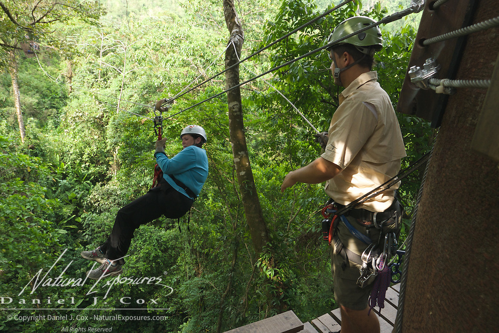 Carol braving her way through the zip line ride. Costa Rica.