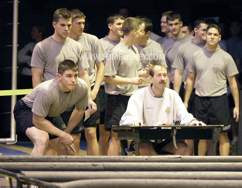 Cadets line up for the start of the Indoor Obstacle Course Test, which begins with the low crawl, in Hayes Gym at the U.S. Military Academy at West Point on Feb. 9, 2010.