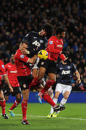 Marouane Fellaini of Man Utd © gets in between Cardiff's Ben Turner (l) and Fraizer Campbell (r). Barclays Premier League match, Cardiff city v Manchester Utd at the Cardiff city stadium in Cardiff, South Wales on Sunday 24th Nov 2013. pic by Andrew Orchard, Andrew Orchard sports photography,