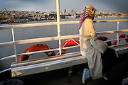 A Turkish girl sits on a ferry boat on the Golden Horn in Istanbul, Turkey, June 29, 2009.<br /> <br /> This image is part of the series 'Bos-for-Us: Daily life on Istanbul Bosphorus'.<br /> <br /> © Giorgio Perottino