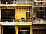 "22 DECEMBER 2017 - HANOI, VIETNAM: Apartment buildings in the old quarter of Hanoi. The old quarter is the heart of Hanoi, with narrow streets and lots of small shops but it's being ""gentrified"" because of tourism and some of the shops are being turned into hotels and cafes for tourists and wealthy Vietnamese.    PHOTO BY JACK KURTZ"