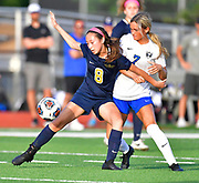 Althoff defender Issy Wendler (left) and Columbia defender Taylor Martin vie for the ball. Althoff played Columbia in the sectional championship game at Althoff High School in Belleville, IL on Friday June 11, 2021. <br /> Tim Vizer/Special to STLhighschoolsports.com.