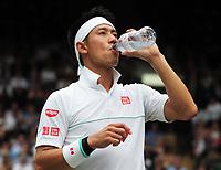 Tennis - 2019 Wimbledon Championships - Week Two, Wednesday (Day Nine)<br /> <br /> Men's Singles, Quarter-Final: Kei Nishikori (JPN) v Roger Federer (SUI)<br /> <br /> Kei Nishikori drinks water on Centre Court.<br /> <br /> COLORSPORT/ANDREW COWIE