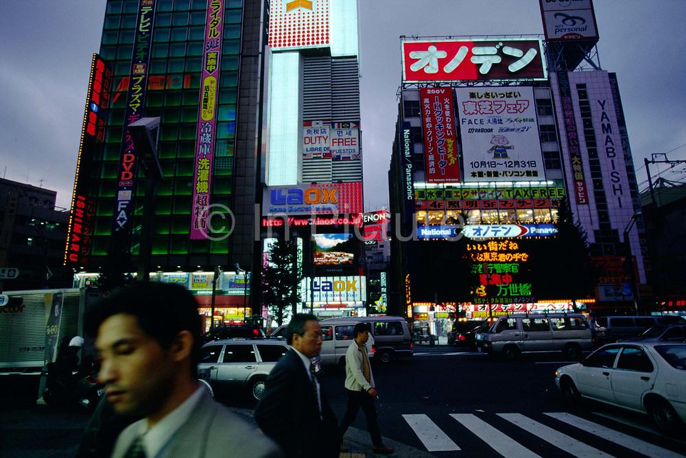 Salarymen make their way home through the Shinjuko district at dusk, Tokyo, Japan