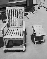 Snow covered deck chair. Image taken with a Fuji X-T1 camera and 16 mm f/1.4 lens (ISO 200, 16 mm, f/8, 1/150 sec). Raw image processed with Capture One Pro (including conversion to B&W).