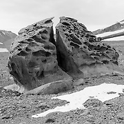 Split ventifact. Ventifacts are rocks shaped by wind blown sand. Because there is no erosion from rain and little from melting snow, the landscape takes on an unusual appearance we are not used to seeing, something closer to a Mars or Lunar landscape.
