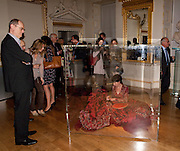 RICHARD CORK LOOKS ON AT PERFORMANCE ARTIST, ROYAL ACADEMY CONTEMPORARY CIRCLE FUNDRAISING EVENT. Royal Academy. Piccadilly. London. 30 September 2010. -DO NOT ARCHIVE-© Copyright Photograph by Dafydd Jones. 248 Clapham Rd. London SW9 0PZ. Tel 0207 820 0771. www.dafjones.com.