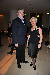 MICHAEL HOWELLS and KITTY ARDEN at a Burns Night dinner in aid of cancer charity CLIC Sargent held at St.Martin's Lane Hotel, London on 25th January 2011.