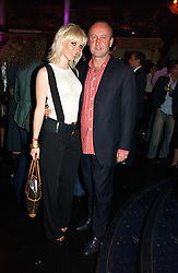 Model CHARLOTTE DUTTON and SEBASTIAN SAINSBURY at a Lonsdale Supper Club party held at the Cafe de Paris, Coventry Street, London on 28th September 2006.<br />