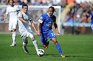 Everton's Steven Pienaar ® goes past Swansea's Pablo Hernandez.  Barclays Premier league, Swansea city v Everton at the Liberty stadium in Swansea, South Wales on Sat 22nd Sept 2012.   pic by  Andrew Orchard, Andrew Orchard sports photography,