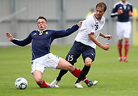 Fotball<br /> Skottland v Norge<br /> Foto: Colorsport/Digitalsport<br /> NORWAY ONLY<br /> <br /> Scotland vs Norway U21<br /> International Challenge Match, New St Mirren Park, Paisley.<br /> <br /> Scott Allan of Scotland is challenged by Anders Konradsen of Norway<br /> <br /> 10th August 2011