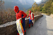 XINXIANG, CHINA - OCTOBER 18: (CHINA OUT) <br /> <br /> Spider-man Collects Garbage<br /> <br /> Two workers dressed as Spider-man collect garbage at Jiulianshan Mountain on October 18, 2014 in Xinxiang, <br /> Henan Province of China. The Jiulianshan Mountain Scenic Spot bought several costumes of Spider-man for cleaners, aiming to remind everyone pay attention to environmental protection.<br /> ©Exclusivepix