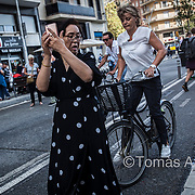 Tourist invading a bike lane to take a picture of the Sagrada Família.