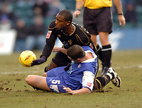 Picture: Henry Browne.<br /> Date: 26/02/2005.<br /> Gillingham v Wigan Athletic Coca Cola Championship.<br /> Nathan Ellington of Wigan is tackled by Barry Ashby of Gills.