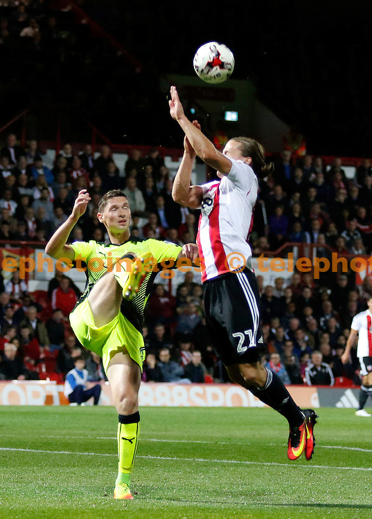 Reading's George Evans clears from Brentford's Lasse Vibe during the Sky Bet Championship match between Brentford and Reading at Griffin Park in London. September 27, 2016.<br /> Carlton Myrie / Telephoto Images<br /> +44 7967 642437