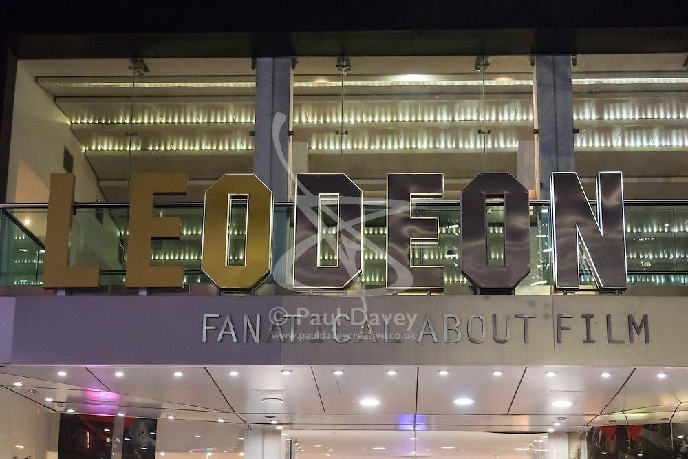 """Leicester Square, London, February 29th 2016. Workers remove the """"LE"""" from the ODEON lign which was added when actor Leonardo DiCaprio won his Oscar for his performance in the Revenant."""