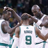 06 March 2012: Boston Celtics power forward Kevin Garnett (5) congratulates Boston Celtics point guard Rajon Rondo (9) and Boston Celtics power forward Brandon Bass (30) during the Boston Celtics 97-92 (OT) victory over the Houston Rockets at the TD Garden, Boston, Massachusetts, USA.