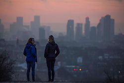 © Licensed to London News Pictures.23/02/2021. London, UK. Members of the public enjoy the sunrise on Hampstead Heath, North London while the third national lockdown continues. Photo credit: Marcin Nowak/LNP