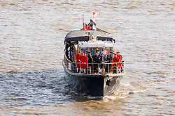 © Licensed to London News Pictures. 11/11/2018. London, UK.  The Havengore with traditional cutters on board in a flotilla of boats including the Royal barge, QRB Gloriana  and traditional boats travels up the River Thames towards the Houses of Parliament in Westminster for a remembrance service, led by the Havengore, as part of Armistice Day centenary events taking place in central London. Big Ben will strike at 11am to mark the start of the two minutes silence and the Havengore will sound her horn to signify the end of the two minutes silence in central London.  Photo credit: Vickie Flores/LNP