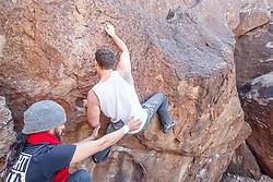 Climbers at Hueco Tanks State Park & Historic Site, El Paso, Texas. USA.