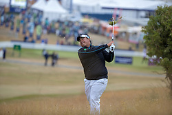 Kiradech Aphibarnrat plays his approach shot from the rough to the 1st green during day one of the Aberdeen Asset Management Scottish Open at Gullane Golf Club, East Lothian.