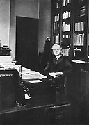Marie Curie (1867-1934) Polish-born French physicist in 1925 in her office at the Radium Institute, Paris, of which she was director of research from 1918-1934