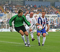 Photo: Andrew Unwin.<br />Hartlepool United v Leeds United. Pre Season Friendly. 22/07/2006.<br />Leeds' Steve Stone (C) battles for the ball.
