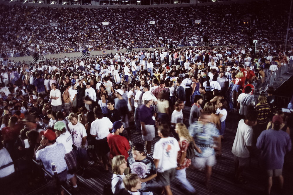 Grateful Dead Live at Soldier Field Chicago. The night before the last show ever performed by the band, July 8, 1995. Stage lighting and set design by Candace Brightman. The Audience, Fans, Deadheads during the break between sets.