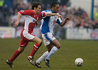 Photo: Leigh Quinnell.<br /> Nuneaton Borough v Middlesbrough. The FA Cup.<br /> 07/01/2006. Middlesbroughs Gareth Southgate gets hold of Nuneatons Brian Quailey.