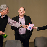US actor John de Lancie (L) receives a book during a meeting with his fans in Budapest, Hungary on January 11, 2015. ATTILA VOLGYI
