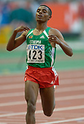 Kenenisa Bekele of Ethiopia wins 10,000 meters in championship record 26:49.57 in the IAAF World Championships in Athletics at Stade de France on Sunday, Aug, 24, 2003.
