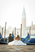 Newly Wed couple in St Mark's Square overlooking San Giorgio Maggiore. Venice, Italy, Europe