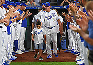 Kansas City Royals manager Ned Yost (3) walks out onto the field with his family before managing his final games with the Royals and retiring from baseball, prior to a game against the Minnesota Twins at Kauffman Stadium.