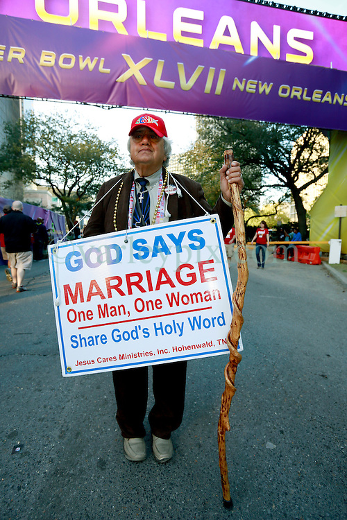 03 Feb 2013. New Orleans, Louisiana USA. .Super Bowl Sunday. A man protests Gay marriage to football fans heading for the Superdome where the city hosts the XLVII (47th) Annual Super Bowl with the Baltimore Ravens against the San Francisco 49'ers. .Photo; Charlie Varley