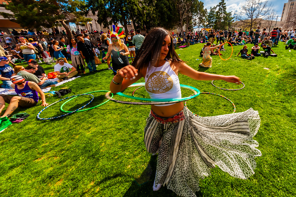 Hullahooping at the 420 Cannabis Culture Music Festival, Civic Center Park, Downtown Denver, Colorado USA. This was the first 4/20 celebration since recreational pot became legal in Colorado January 1, 2014. A crowd of up to 80,000 people attended the event.