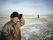 Men walking near concrete yaks. <br /> Travels in the Gobi desert region. <br /> Travels in the Gobi desert region.