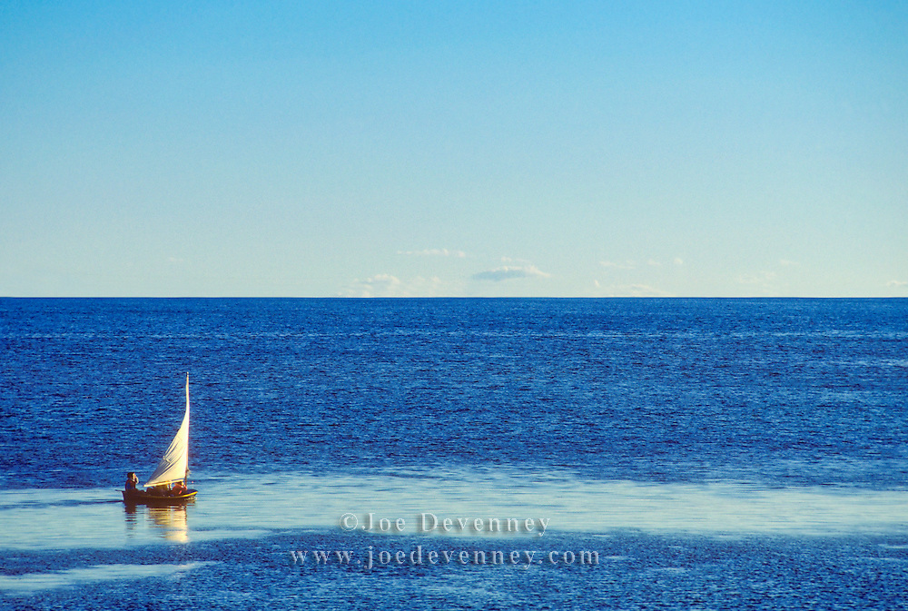 Small sailing skiff in Penobscot Bay. Rockland, Maine