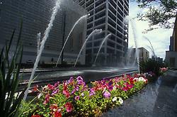 Stock photo of fountains spraying over the Metro light rail track in downtown Houston Texas