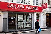 Closed down chicken restaurant on Berwick Street Soho, London. The economic downturn has seen many businesses fail and close due t economic hardship.