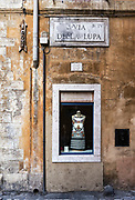 Dress shop window display on old street, Rome, Italy