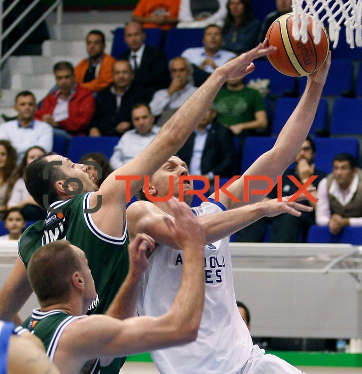 Anadolu Efes's Dusko SAVANOVIC (R) during their Turkey Cup Qualifying basketball third match Anadolu Efes between Aliaga Petkim at Aliaga Arena in Izmir, Turkey, Tuesday, October 11, 2011. Photo by TURKPIX